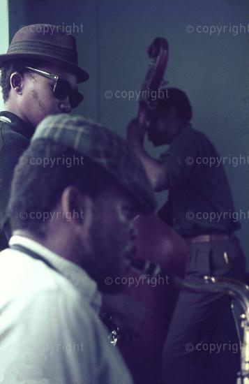 Nikele Moyoke playing the tenor saxophone accompanied by Makay Davashe on the tenor saxophone and Gus Ntlokwana on the double bass