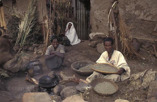 Women preparing food outside their house, Bahir Dar, Ethiopia