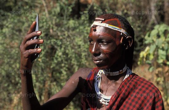 Maasai warrior with  painted face, Tanzania