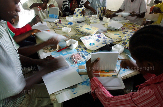 2006/09/06.  Manufacturing exercise books for new school year in Yaounde.